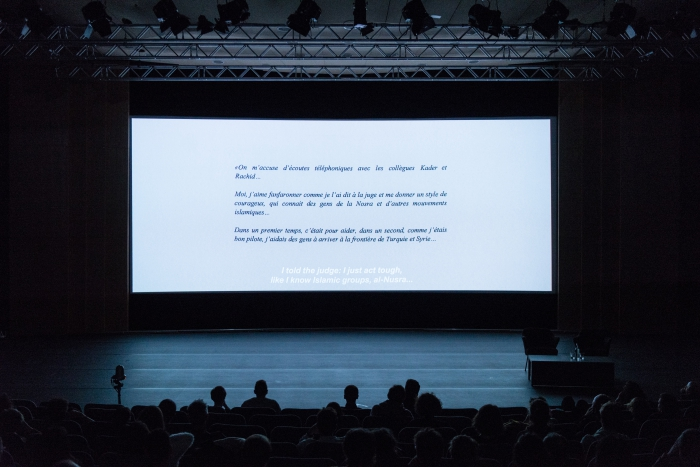 "Impression of the screening ""Also Known As Jihadi"" at transmediale 2018 face value."