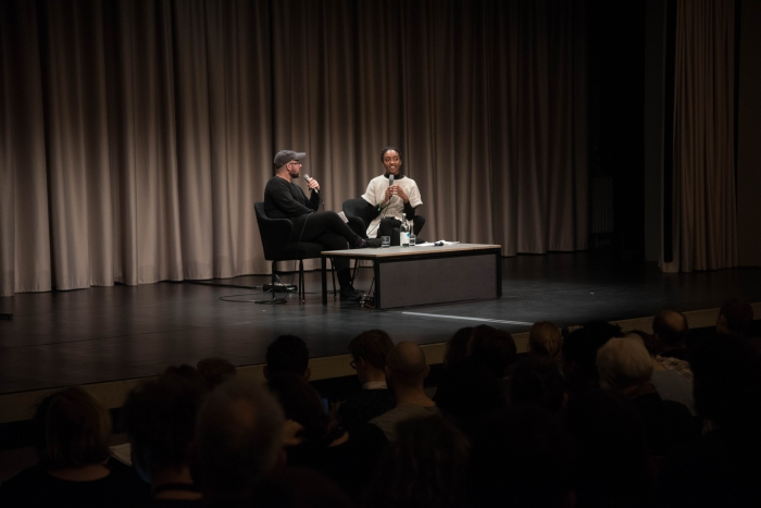 "Zach Blas (left) and Aria Dean (right) at the discussion ""Reimagine the Internet: Affect, Velocity, Excess"" at transmediale 2018 face value."